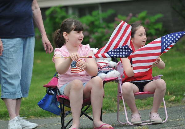 Danvers: Kayla Sherry of Beverly, 8 and Emma Hatch of Danvers, 6, wave flags at the memorial day parade  photo by Mark Teiwes / Salem News