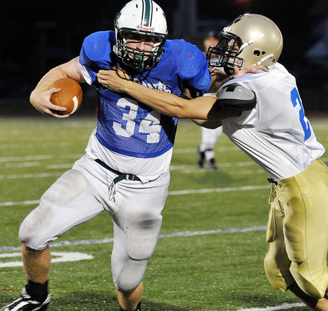 Lynn: Manchester-Essex player Brian Ciccone battles to gain yards during a carry at the 49th annual Agganis All-Staff Football Classic  photo by Mark Teiwes / Salem News