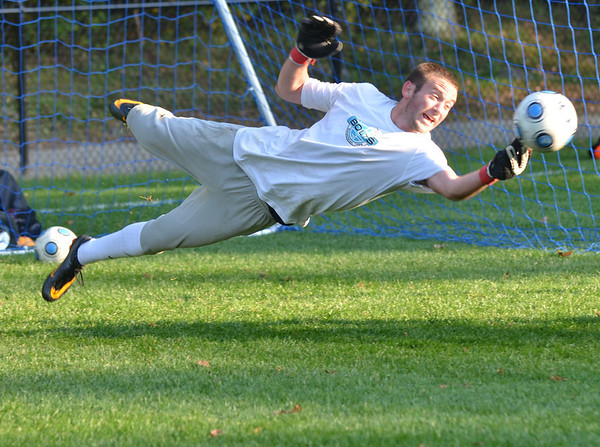 Danvers: St. John's Prep soccer goal keeper Kenn Fryerdives for a save during practice. photo by Mark Teiwes / Salem News