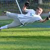 Danvers: St. John's Prep soccer goal keeper Kenn Fryerdives for a save during practice. photo by Mark Teiwes / Salem News