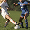 Beverly:  Beverly's Eva Gourdeau, left, and Danvers player Brittney Zecha work to control the ball.   photo by Mark Teiwes / Salem News