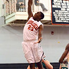 Marblehead: Marblehead's Malik Abu makes a decisive dunk in the team's 71-63 win over Lynn Classical. photo by Mark Teiwes / Salem News