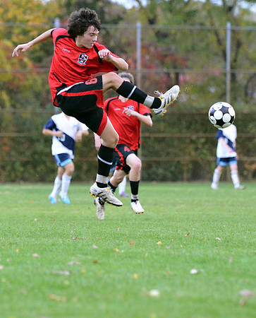 Peabody:  Salem's Austin Shea volleys the ball during a 3-2 Salem win over Peabody.    photo by Mark Teiwes / Salem News