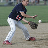 Lynn: Peabody West Little League short stop Jake Doherty makes a play for an out.   photo by Mark Teiwes  / Salem News