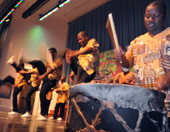 Salem: Paul Ramafalo, right, lays down a drum beat as the group Thula Sizwe dances.    photo by Mark Teiwes / Salem News
