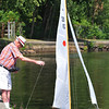 Marblehead:  Ned Lakeman, former Marblehead resident, pushes off his radio-controlled Cup Racer for a race around Redds Pond.  He has been a member of the race club since 1946.    photo by Mark Teiwes / Salem News