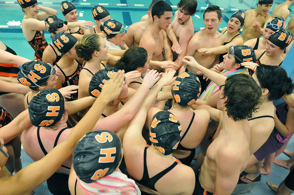 Beverly: Beverly High School swim team gets together for a cheer before a swim meet versus Peabody.   photo by Mark Teiwes / Salem News