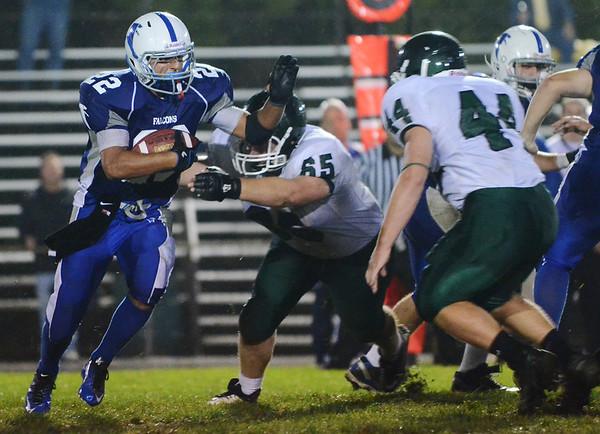 Danvers: Danvers High School football captain Nick Valles runs for a carry against Pentucket. photo by Mark Teiwes / Salem News
