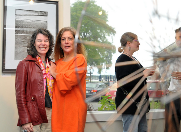 Salem: Mary Beth Bainbridge, left, and Elise Mankes helped to hang the show at for gallery at 63A Pickering Wharf.  photo by Mark Teiwes / Salem News