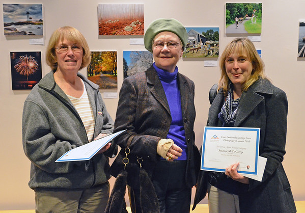 Salem: Second prize winner Marion J. Bayly of New York City, left, Christina Kelly of Lynn, and third prize winner Suzanne DeGeorge attended the Essex Heritage photo contest opening reception.  photo by Mark Teiwes  / Salem News