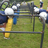 "Peabody: Players run through drills throught ""the chute"" at Peabody High School football practice.  photo by Mark Teiwes / Salem News"