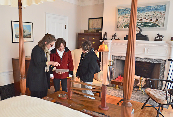 Salem: Historic New England tour guide Rosamond Smith, leads Susan Grady and Margot Messier of Danvers on a tour of Stevie Phillips bedroom in the Phillips house.  Grady is the grand-neice of Delia Caliey who was on staff at the house as a waitress maid in the early 1900's.  photo by Mark Teiwes  / Salem News