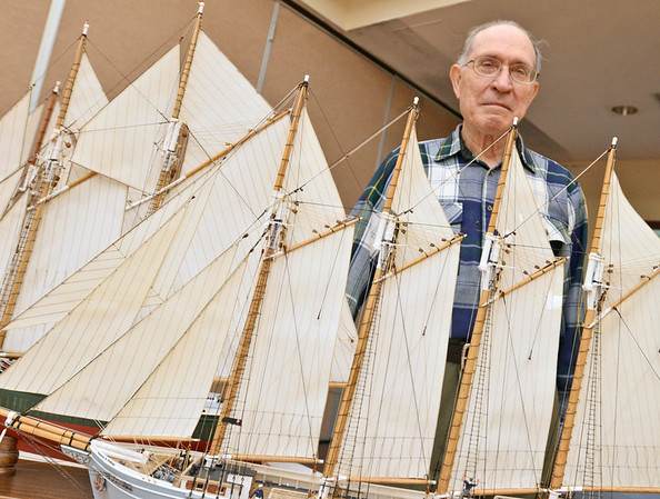 Peabody: Marcy Consalvo of Peabody stands with his model fishing, cargo and whaling schooners, which are part of the model ship show this weekend at the Torigian community center, 79 Central Street, Peabody. photo by Mark Teiwes / Salem News