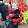 Salem: Tristan Shea, 2, of Salem, carries a bag of candy along Essex Street for the Mayor's Night Out trick-or-treat.  photo by Mark Teiwes / Salem News