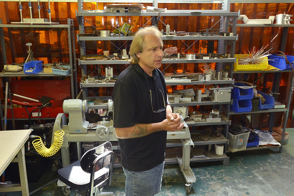 Danvers:  Ed Jordan is the owner of machine shop Metallic Fusion in Danversport.  photo by Mark Teiwes / Salem News