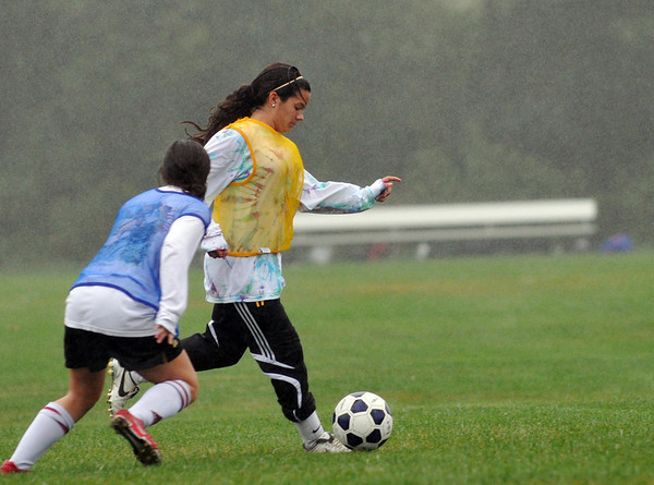 Peabody:  Kristin Verrette, right practices with her team playing center midfielder and forward in games.