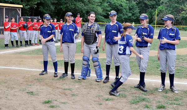 Danvers: The all girls Rockford Peaches line up before a game against a Salem boys team at the Stan Brown Youth Baseball Jamboree. The Peaches have won three previous games in the jamboree.  photo by Mark Teiwes / Salem News