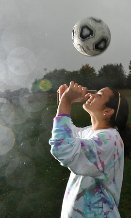 Peabody:   Bishop Fenwick girls soccer player Kristin Verrette heads the ball while practicing with her team in the rain.