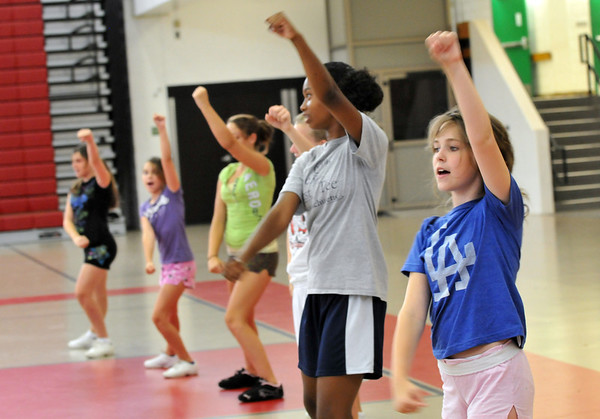 Salem: Jordan Harrington, 13, of Salem, right, works through a cheer routine during the clinic.  photo by Mark Teiwes / Salem News