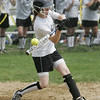 Peabody: Bishop Fenwick's Jennifer Crovo makes contact for a base hit.  photo by Mark Teiwes / Salem News