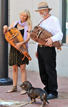 Salem: Street musicians Anicet Heller, left and her husband Donald play European Baroque Hurdy-Gurdies entertaining for the Essex Street Fair.  photo by Mark Teiwes / Salem News