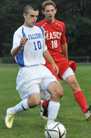 Danvers: Danvers player Matt Hogan, left, looks for a pass covered by Masconomet's Justin Clark.  photo by Mark Teiwes / Salem News