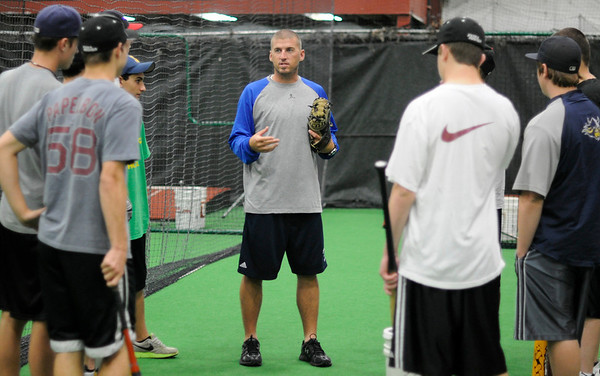 Middleton: Former Peabody High, UMass-Lowell and minor league player Jon Cahill, center, is the new Director of Baseball Operations at Extra Innings.  He talks with a team that he is training at the facility.  photo by Mark Teiwes / Salem News