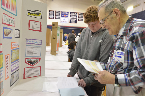 Middleton: George Shirn of Hamilton, right, reviews Patrick Hogan's bread mold North Shore Tech science fair project.  Mr. Shirn went to a technical high school school, then later went on to get a PHD in physics and work for a company that made parts for NASA.  photo by Mark Teiwes / Salem News
