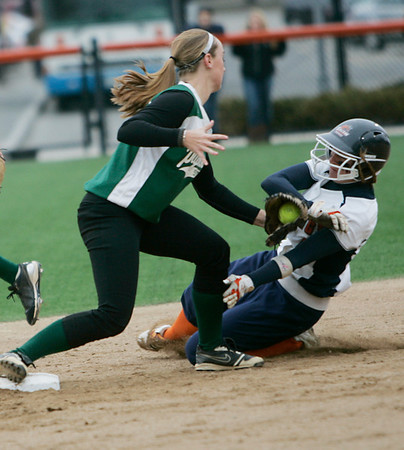 Salem:  Salem State's Taylor Orlando, right, is tagged out at second by Plymouth State's Jackie Digman.  photo by Mark Teiwes / Salem News