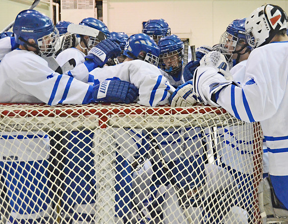 Salem: Danvers High School boys hockey team gathers together before thier game against Gloucester.  photo by Mark Teiwes / Salem News