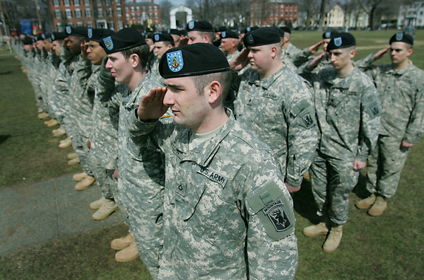 Salem: David Woodfin from Beverly salutes at the Salem Common.  He served with the 101st Field Artillery Regiment in Afghanistan.  The group is adjusting to civilian life and reconnecting with family after returning in December.  photo by Mark Teiwes / Salem News
