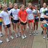 Marblehead:  Head coach Jennifer Rodier, right, talks over the day's work out with the Marblehead High Girls Cross Country team. photo by Mark Teiwes  / Salem News