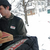 Beverly: Papa Gino's delivery man Steve Gendall, 22, of Beverly makes a delivery on Harrison Street, about 3 blocks away from the restaurant..  photo by Mark Teiwes / Salem News