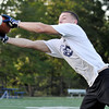 Danvers: St. John's Prep player Austin Pierce reaches for the ball while practicing with NFL veteran Brian St. Pierre. Mark Teiwes / Salem News