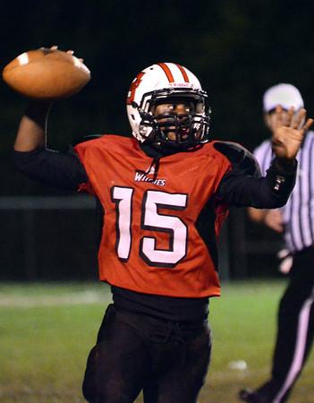 Salem: Salem quarterbak takes aim for a touchdown pass. photo by Mark Teiwes / Salem News