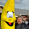 Topsfield:  David Taylor of Gloucester poses with an oversized banana he won at the fair yesterday.