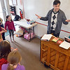 "Danvers: Andy Diskes, center, leads a Neverland Theatre rehearsal at the Crocker School for the musical ""Annie"".  photo by Mark Teiwes / Salem News"