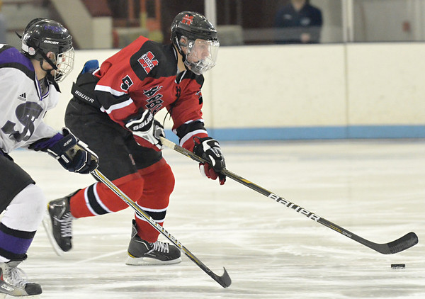 North Billerica: Marblehead's Tom Koopman advances the puck.   photo by Mark Teiwes / Salem News