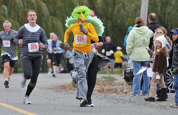Salem:  Silio Rossi of Marblehead, dressed as a bird, comes down the final stretch of the road race.  photo by Mark Teiwes / Salem News