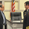 Danvers Town Clerk Joseph Collins, left, officially swears in Kevin Farrell as the Danvers Fire Chief .  photo by Mark Teiwes / Salem News