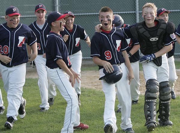 Lynn: Peabody West Little League players celebrate #9 Nick Palmer's  home run.  photo by Mark Teiwes  / Salem News