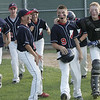 Lynn: Peabody West Little League players celebrate #9 Nick Palmer's  home run.  photo by Mark Teiwes  / Salem News