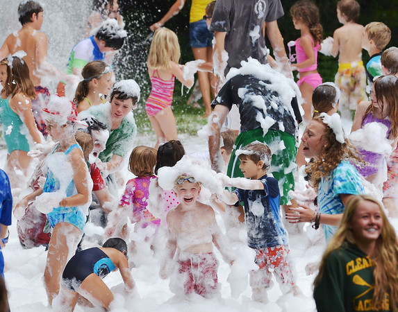 Wenham: Kids play in foam during a summer program run by the Wenham Village Improvement Society with over 200 children enrolled and 50 local teenagers that work as counselors.  photo by Mark Teiwes / Salem News.