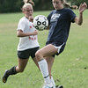Salem: Hamilton-Wenham's Lily Shiland, right, gains control of the ball defended by Salem's Sydney Hanford.   photo by Mark Teiwes /  Salem News