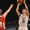 Worcester: St. John's Prep player Steve Haladyna make a shot form outside. photo by Mark Teiwes / Salem News