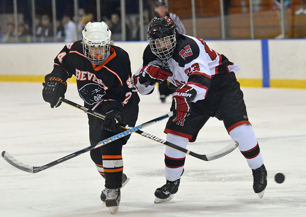 Salem: Beverly's Mike Von Zweck, left, and Marblehead's Austin Haley battle for the puck during Bevelry's 3-2 win on Saturday.  photo by Mark Teiwes  / Salem News