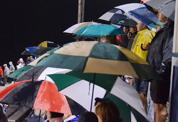 Danvers: Danvers High School football fans huddle together to stay dry during Friday night's game against Pentucket.  photo by Mark Teiwes / Salem News