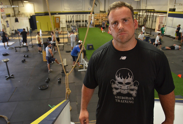 Danvers:  Pat Downey, owner of Gridiron Training, shares the workout space with the North Shore CrossFit. photo by Mark Teiwes /  Salem News