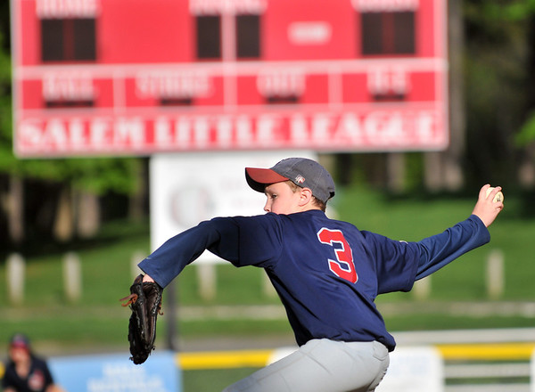 Salem: Salem Little League Majors Indians pitcher Jack Crawley winds up for a pitch.  photo by Mark Teiwes / Salem News