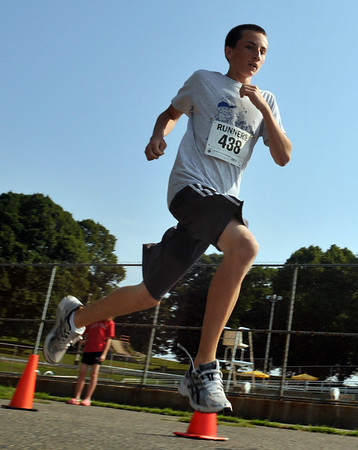 "Salem:  Timmy Ryan, 13, of Salem, wins the ""Wicked Kidz Run"" for the second year in a row with a time of 2:36 for a half mile. Timmy said he does train but he does play baseball.   Mark Teiwes / Salem News"
